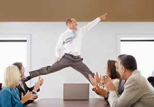 photo of an office worker jumping for joy