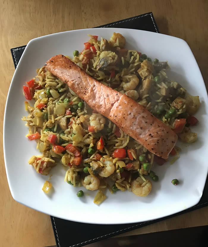 Photo of a plate of Rice with a Salmon fillet on top